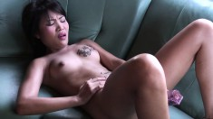 Gorgeous Japanese broad pounds away at her tight pussy on camera
