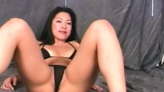 Desirable Oriental babe Kazuka reveals her curves in her black bikini