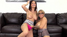 Busty babes Alyssa and Syren get down to munching and toying pussies