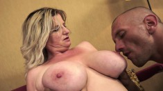 Big tit granny titty fucks him before he jams it in her hungry cunt