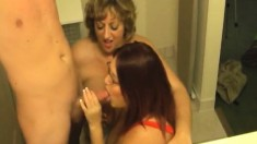 Fat MILFs Jammin Jennie and Peaches LaRue blow and titty-fuck a cock