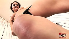 Sexy slender babe with a hot ass drives her shaved pussy to orgasm with a dildo