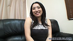 Gorgeous Asian milf craving for action strips off her dress and reveals her body