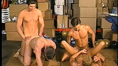 Group of hot studs enjoy some anal action in huge indoor orgy