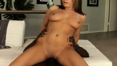 Nicole Banks can barely fit this big black snake in her mouth