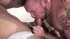 Tattooed hunk relishes every thrust of his lover's shaft up his ass