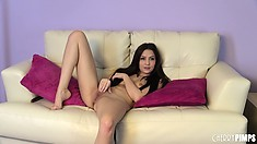 Naughty young brunette Cassie Laine wets her fingers and slides them in her twat