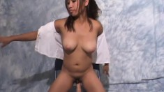 Cute Asian babe with a nice tan squats down to ride on a dildo