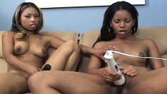 Sultry black lesbians use sex toys to give each other intense pleasure