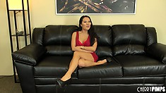 Asian hottie Asa Akira sits on the couch getting an interview