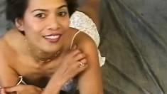 Irresistible Asian cougar Maria sensually caresses her wonderful body