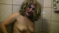Lustful and lonely blonde milf pleases her aching snatch in the shower