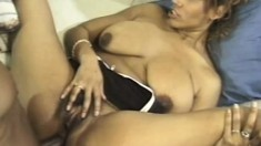 Lustful ebony woman with huge boobs takes a big black dick in her ass