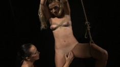 Blonde mistress ties a young girl up and plays with her hot body