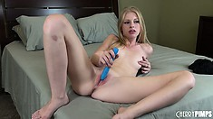 Blonde twit Avril Hall toys her twat on the bed using a vibrating dildo