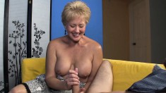 Horny blonde Aunt Tracy bares her boobs to give young Billy's boner a good jerking