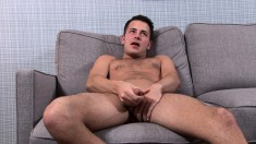 Attractive boy Logan James puts his hands to work on his throbbing rod