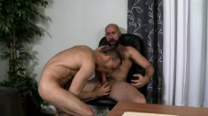 Business hunks blow each other's big cocks and engage in hot anal sex