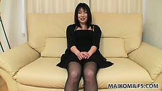 Seductive Asian milf in a sexy black dress shares her sexual fantasies and desires