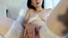 Brunette milf in stockings masturbating by dildo on webcam