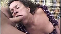 In the outdoors, a hot mature lady with nice tits brings her sexual fantasies to life