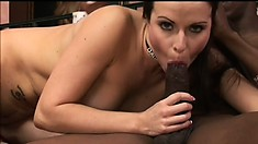 Cute brunette spreads her hot legs to take a black rod deep in her cunt