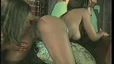 Busty black babe has her lesbian lover drilling her tight juicy peach with a dildo
