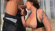 Kayla Quinn, a busty brunette cougar with a lovely ass, sucks and fucks a black dick