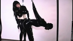 Dominant lady Anastasia Pierce has her way with a latex slave