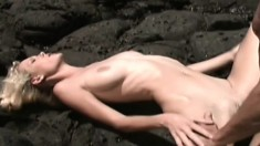 Blondie and her fuckmate take it to the deserted beach to bang there