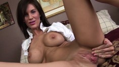 Stacked brunette cougar Brandi lies on the bed and fucks a huge dildo