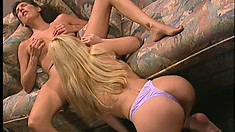 Stunning lesbian babes turn up the heat with some anal toy play