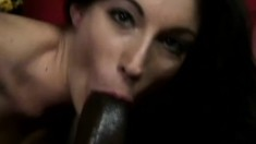Slim brunette milf smokes a cigar and works her lips on a black cock